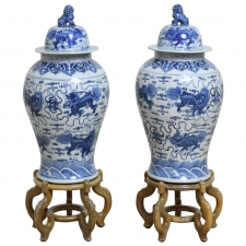 Pair of 20th Century Chinese Blue and White Porcelain Urns with Lids on Stands