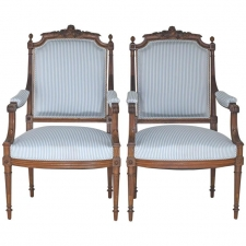 Pair of French Upholstered Louis XVI Style Armchairs in Carved Walnut circa 1880