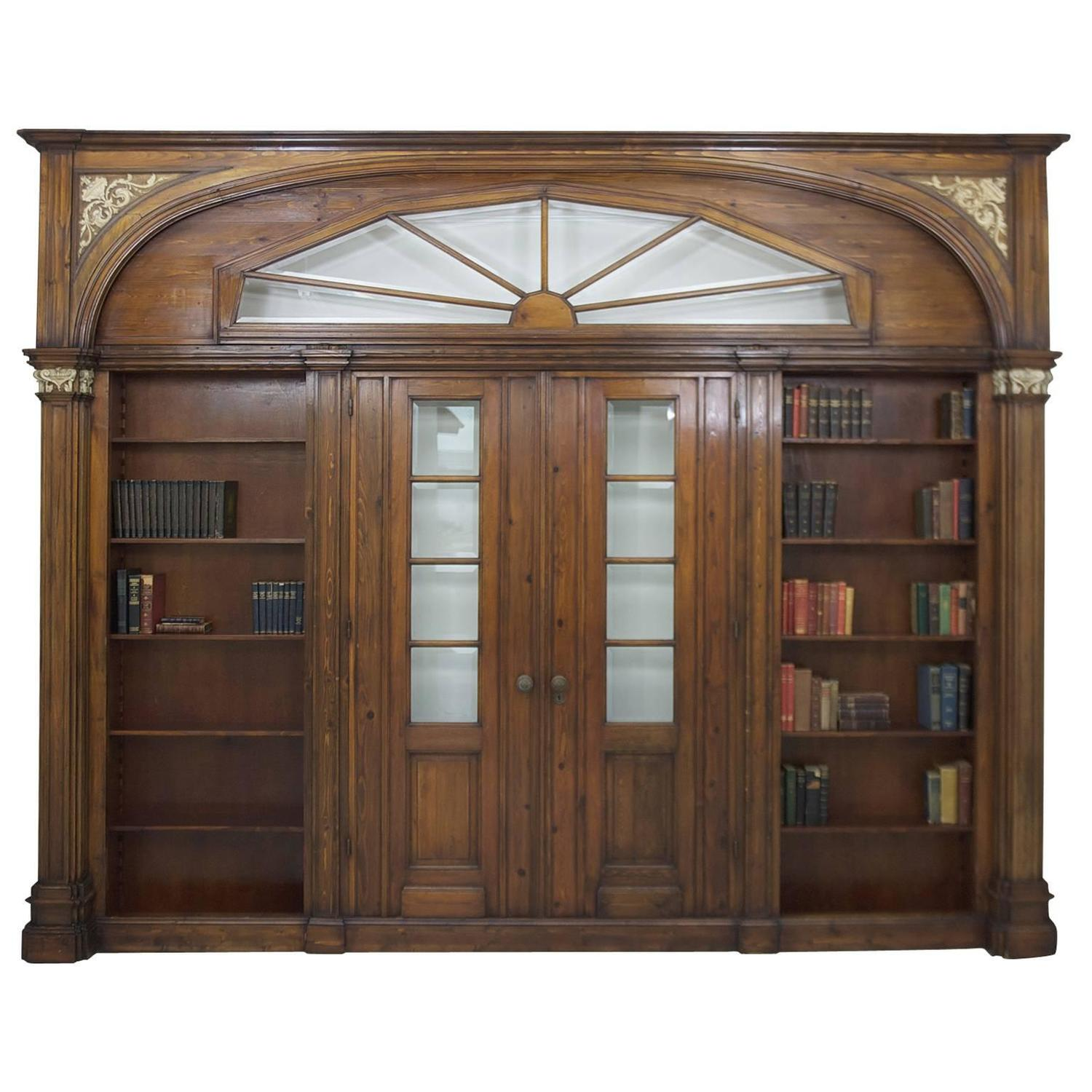 large architectural pass through with bookcases flanking two entry