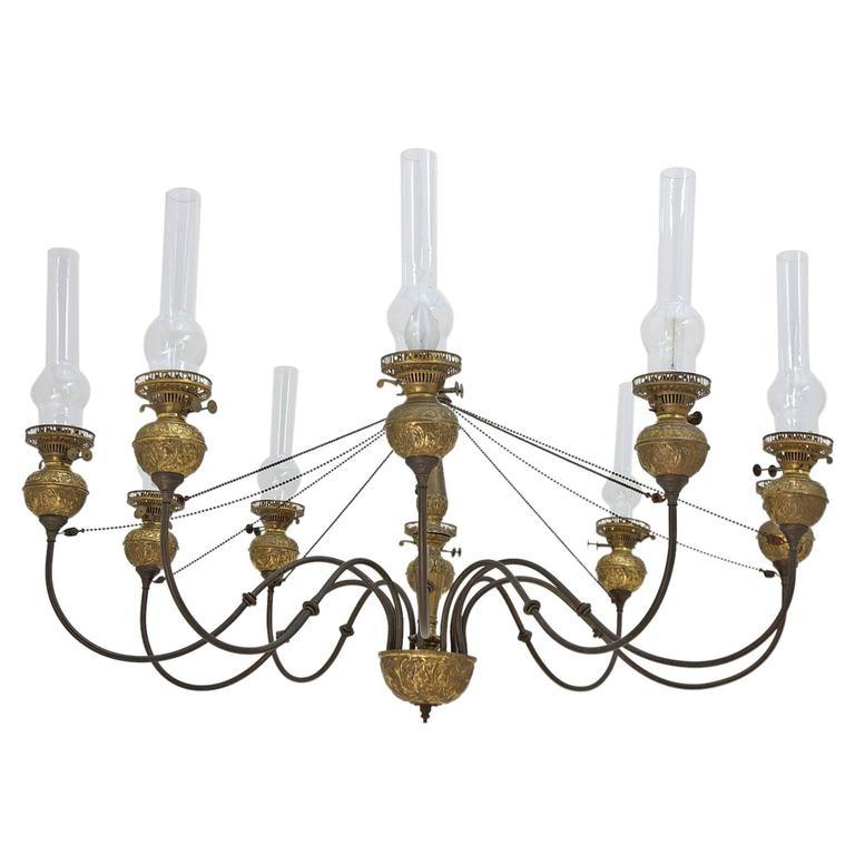 English Victorian Ten Light Chandelier In Brass With Glass Chimneys Circa 1870