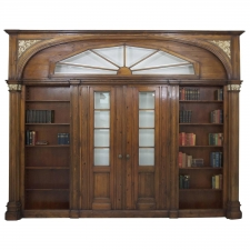 Large Architectural Pass-Through with Bookcases Flanking Two Entry Doors